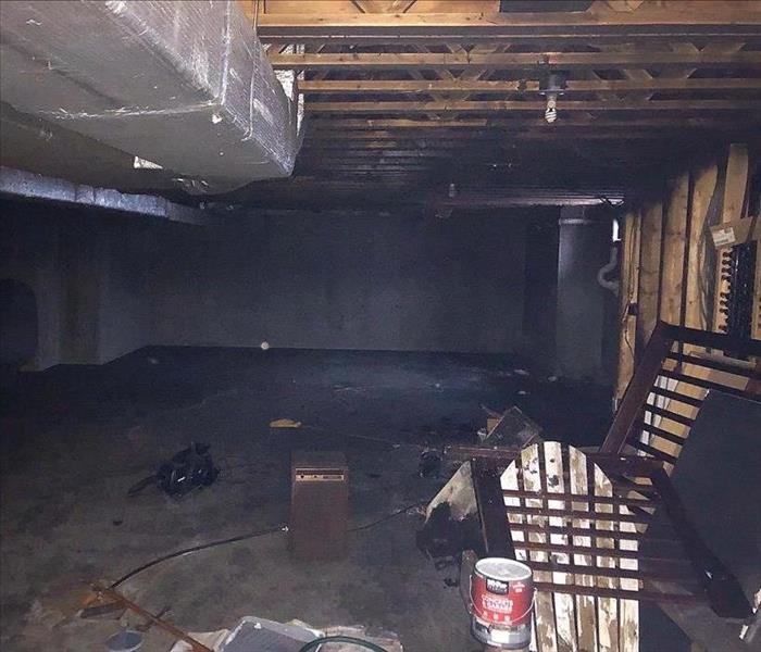 A clean, painted basement after a fire damage clean up