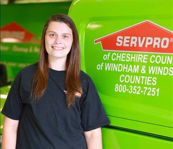 SERVPRO employee in front of a SERVPRO van