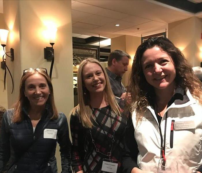 Three ladies at a networking event
