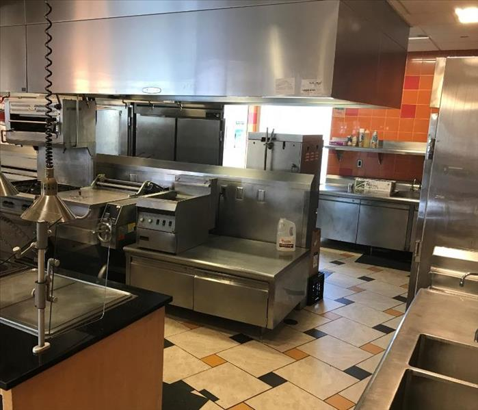Commercial kitchen including sinks, refrigerators, cooktops and other cooking equipment.