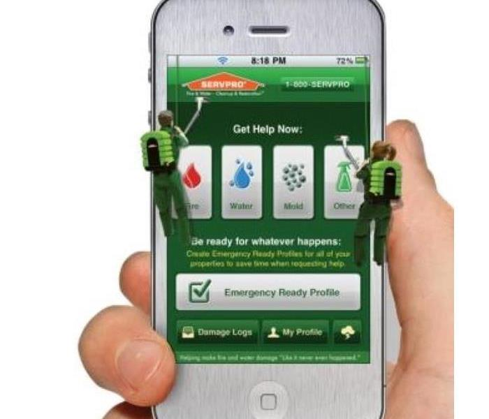 Hand holding a smartphone with the SERVPRO Ready App open.