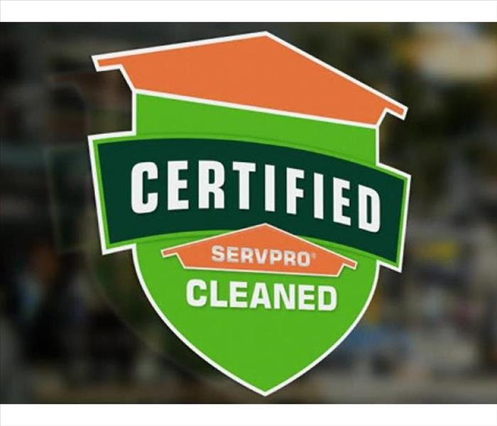 A window decal that says SERVPRO Certified Cleaned