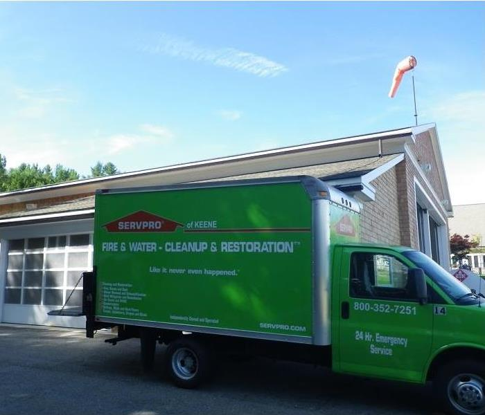SERVPRO box truck parked on location at a commercial property.