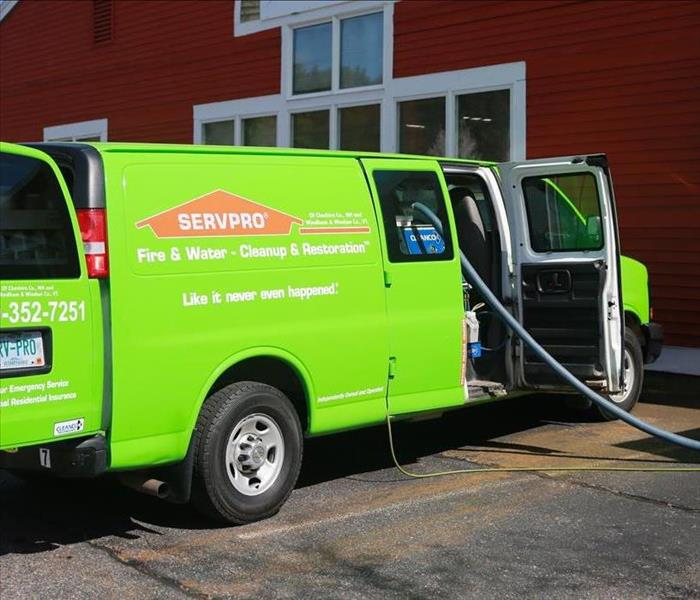 a SERVPRO van outside of a building