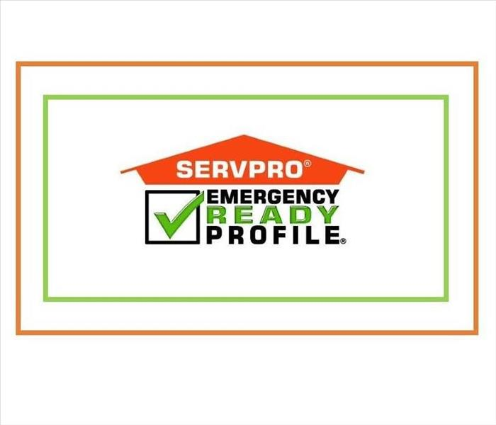 orange, black and green SERVPRO Emergency Ready Profile logo with green checkmark, white background, orange and green frame