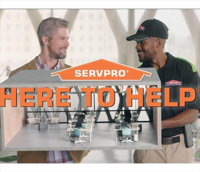 SERVPRO technician discussing cleaning with client