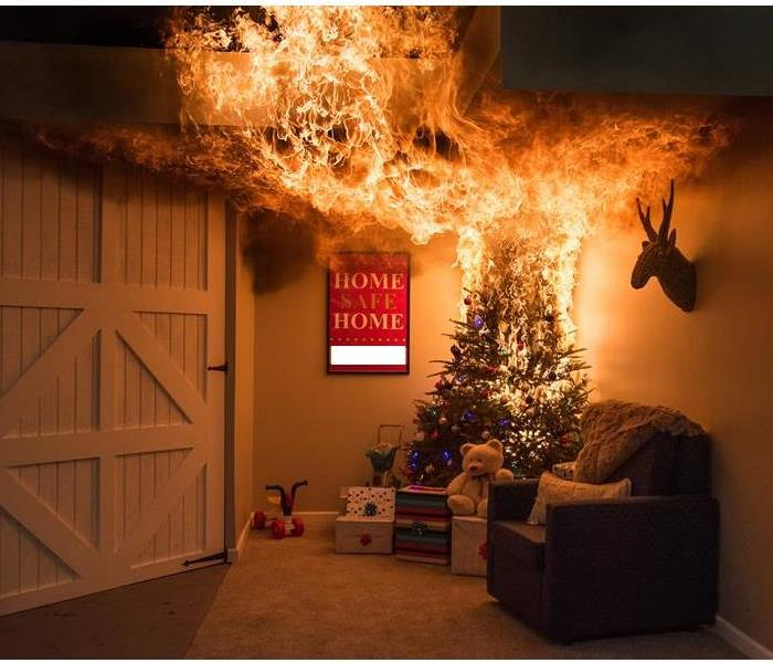 A living room with a Christmas tree that is on fire