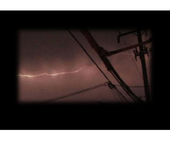 power lines, white bolt of lightning in the distance, soft edges on photo with black background