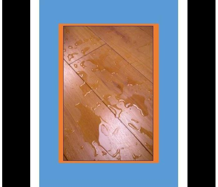 picture of water on a wooden floor with orange and blue background